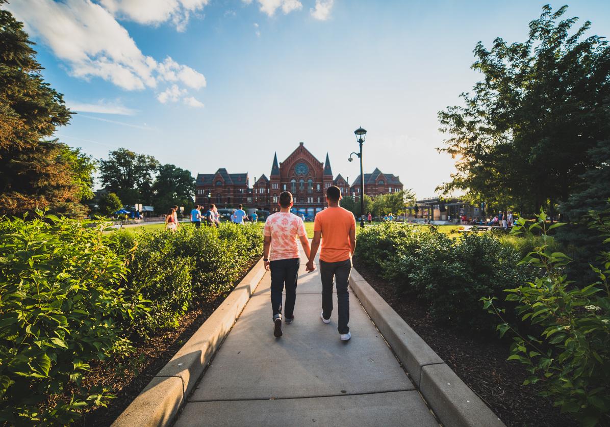 two men walking to Music Hall through Washington Park