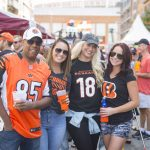 friends smiling at a Cincinnati Bengals tailgate party