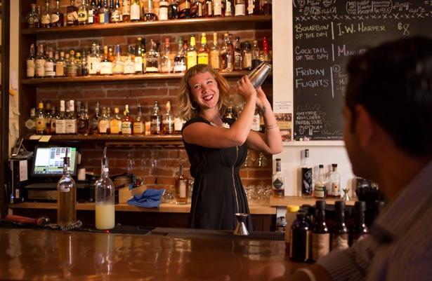 bartender smiling at Old Kentucky Bourbon Bar