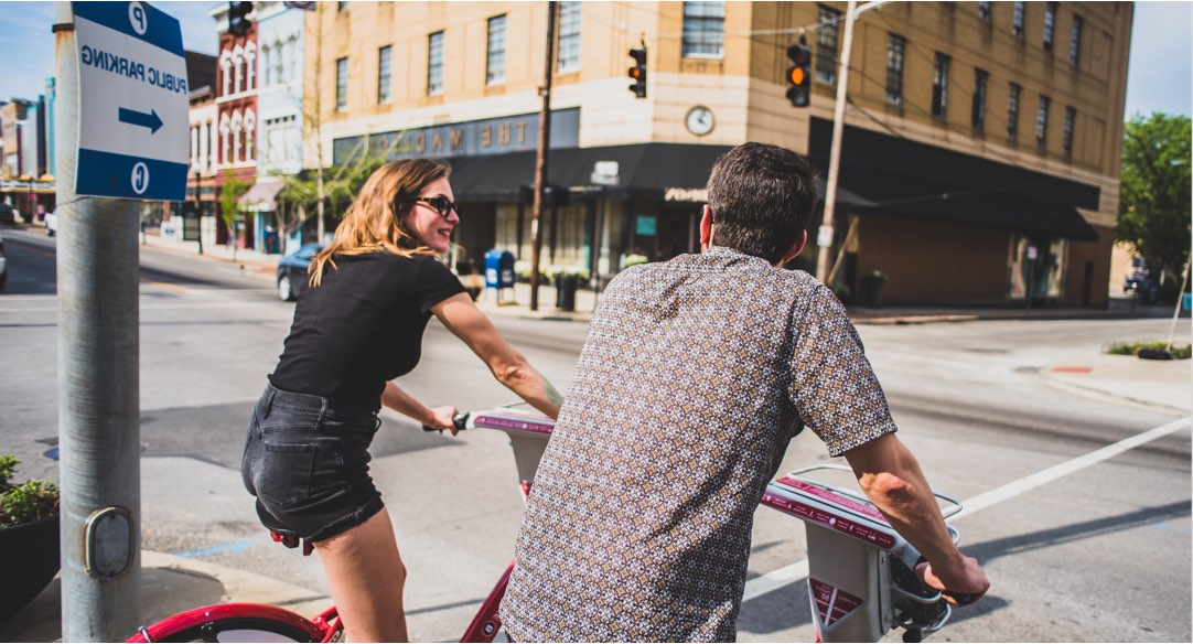 couple riding bikes through Cincinnati
