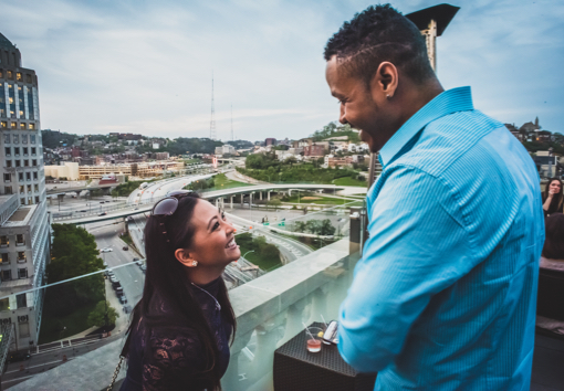 couple laughing at rooftop bar in downtown Cincinnati