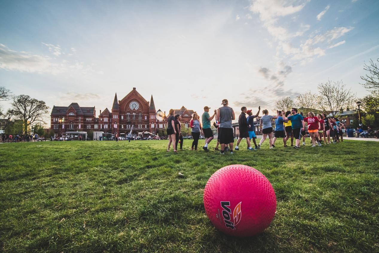 young adults playing kickball in Washington Park