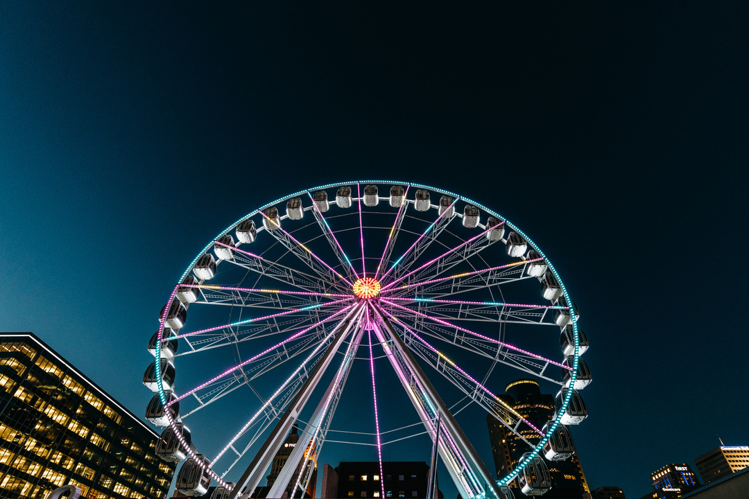 Skystar Wheel on the Riverfront lit up at night