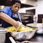 cook in kitchen at Bridges