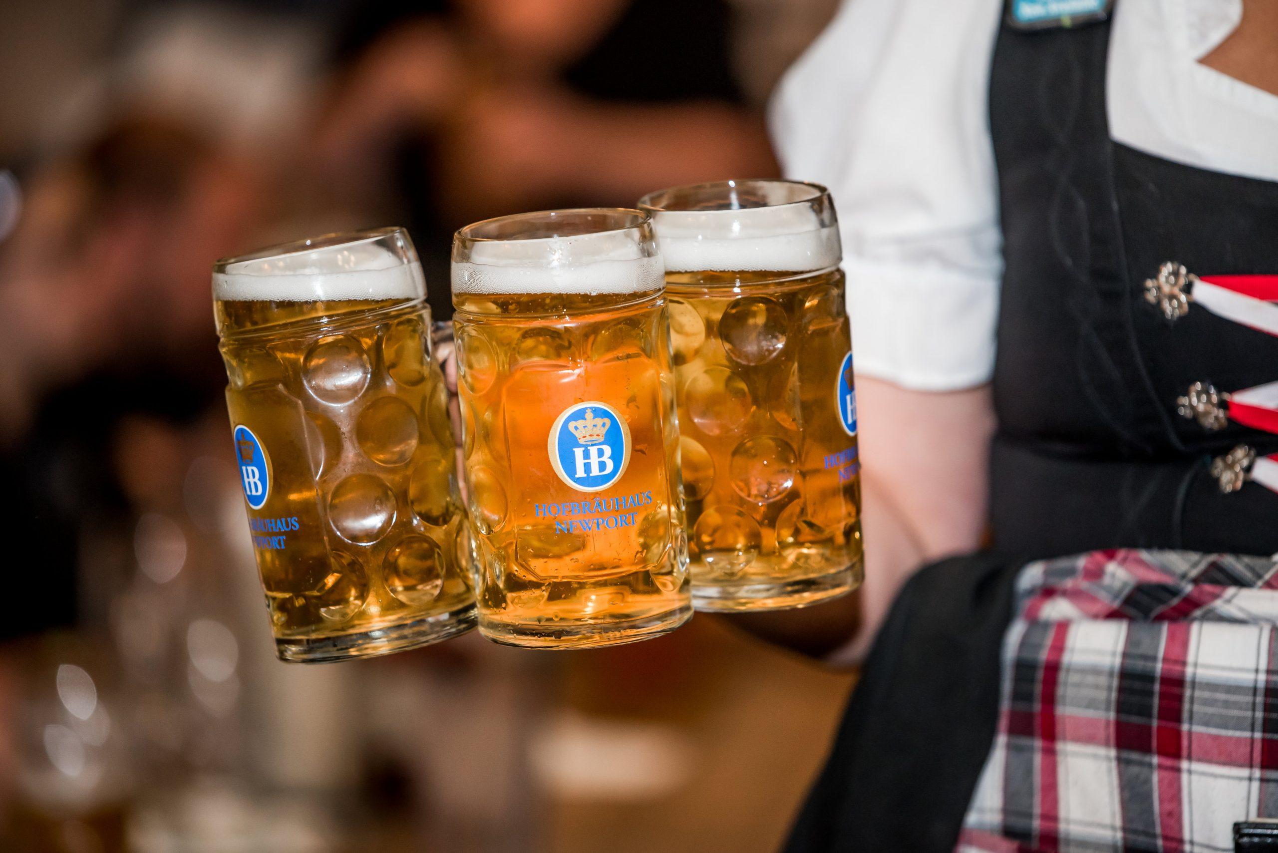 3 Authentic German Beer Steins carried by waitress in Cincinnati brewery